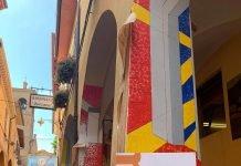 Muro dipinto Dozza artista Grelo