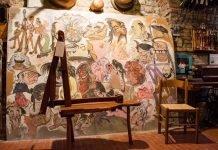 caricature artisti muro dipinto Dozza